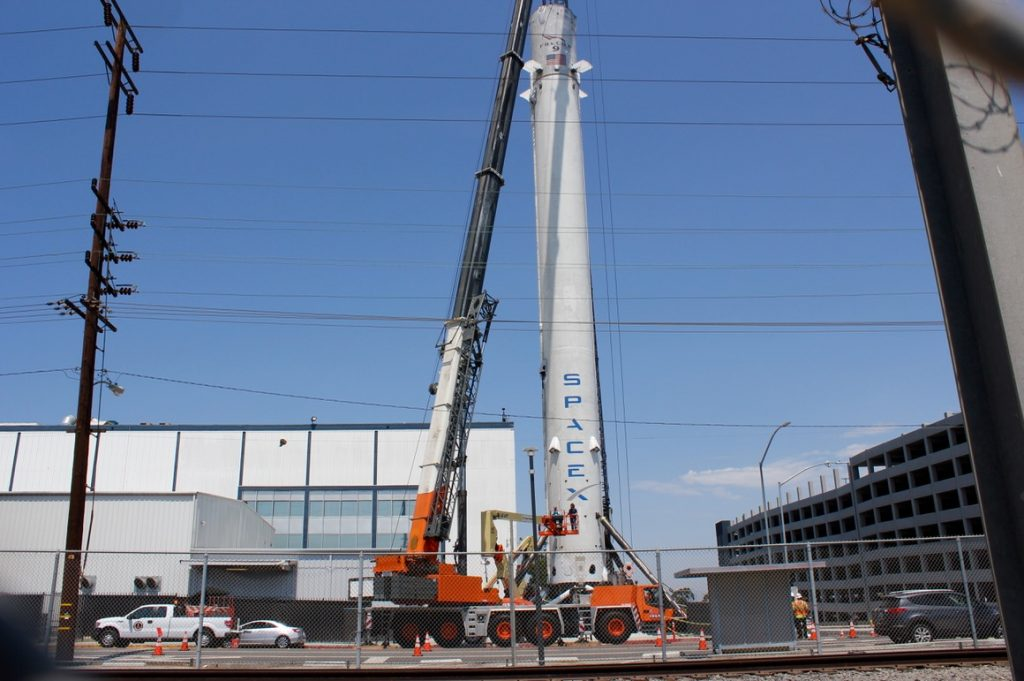 August 20, 2015: SpaceX historic Falcon 9 booster placed outside of company headquarters in Hawthorne, CA as historic monument.